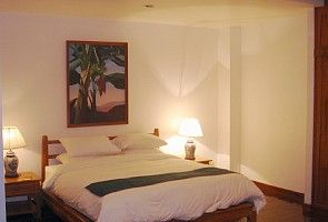 Master bedroom accommodates extra beds.