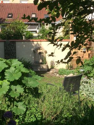 Photo for A secret garden in the heart of Dijon, 10 minutes from the Burgundy countryside