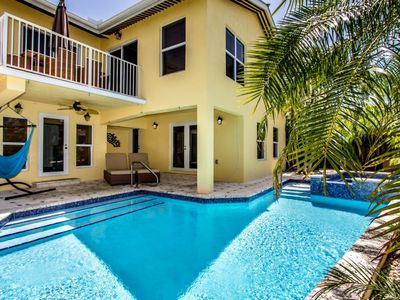 Photo for Sweet Retreat 4 bedroom 2.5 Bathroom near Sombrero Bch w Pool, Dock & Jacuzzi