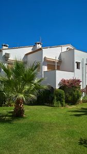 Photo for Ground floor apartment set in beautiful gardens with pool, free WiFi and aircon