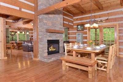 Double sided fireplace opens to dining and living rooms, dining for 10