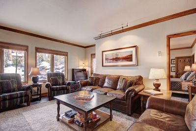 Large living area with a sleeper sofa.