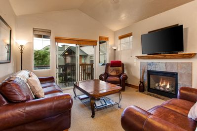 The Living Room at Fox Point with Gas Fireplace, Smart TV, Contemporary Mountain Furnishings and Private Patio Access