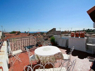 Photo for Charming old town house, sea view, roof terrace, summer kitchen