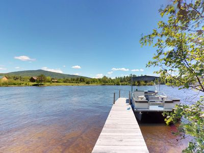 Photo for Lakefront garden cottage w/ private dock, kayak, pebble beach, yard & firepit!