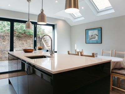 Photo for Chic and remarkable home with glass doors leading out to a lovely garden (Veeve)
