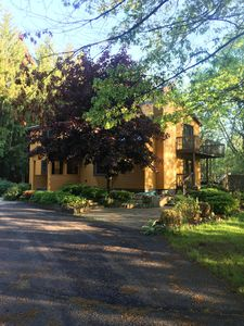 Photo for Stunning home, in private wooded area within walking distance to the beach:)