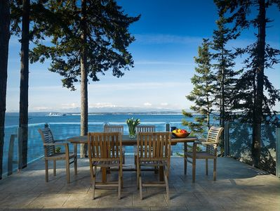 Dine al fresco on the deck-  glass railing highlights the magnificent views