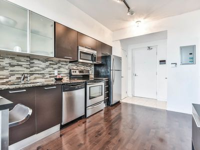 Photo for Retreat to a stylish flat in the heart of Toronto