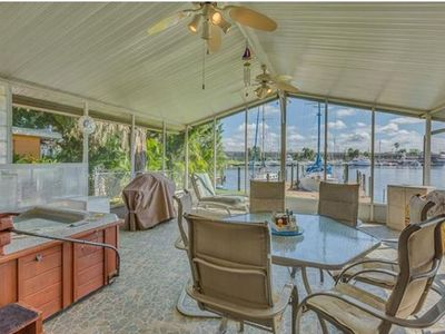 Tropical Waterfront 2bdrm sleeps 6 w/boat slip available behind home!