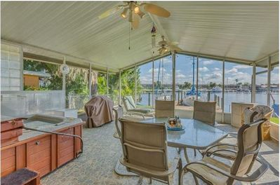 Spacious patio area with hot tub and full size pool table overlooking the Bay