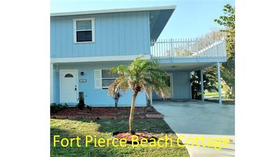 Pull into your private & quiet carport.Hear the waves as you head towards beach.