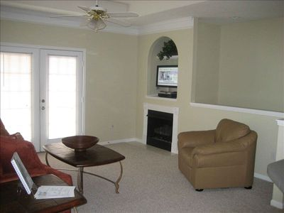View of the living area with fireplace and flat screen tv
