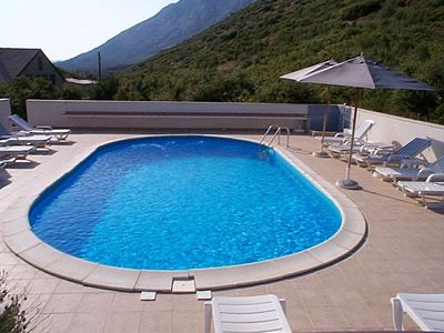 Photo for Lovely apartment for 4 people with pool, A/C, WIFI, pets allowed and parking