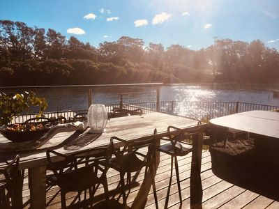 Photo for Absobeachy Couples Retreat-Waterfront with pontoon, spa, fireplaces&pet friendly