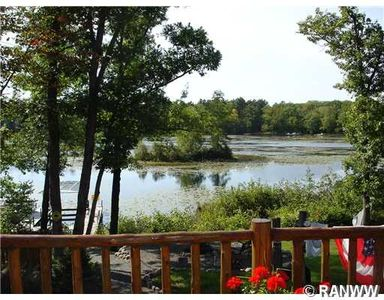 Relax on the deck overlooking the beautiful, quiet bay of Placid Lake...