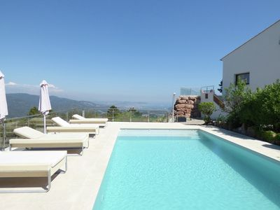 Photo for Luxurious, modern villa with private heated pool and panoramic sea views
