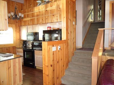 kitchen and stairs from entry