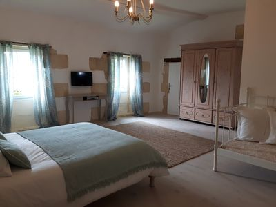 Large room with tv and tea & coffee making facilities.