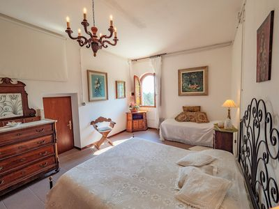 The charming bedroom dressed in Tuscan lace with magnificent views