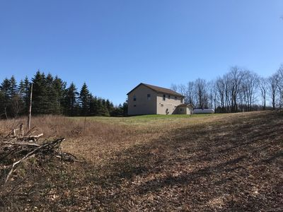 Photo for Beautiful secluded Chalet on 80 acres bordering the Manistee National Forest.