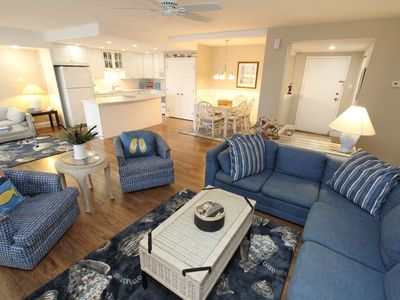 Photo for LINENS INCLUDED*! OCEANFRONT/BOARDWALK BUILDING W/ROOFTOP POOL. Come stay in this comfortable unit! A fully equipped kitchen, washer/dryer, plenty of living space, a rooftop pool, oceanfront/boardwalk front building