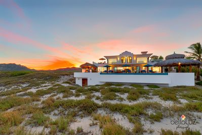 THE HOUSE IS SET BACK ON THE BEACH AMIDST GRASSY DUNES