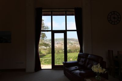 The view across the village and surrounding hills, from the lounge.