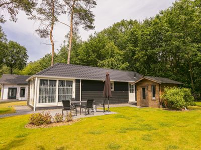 Photo for Beautiful chalet on the water, located in a holiday park with a swimming pool