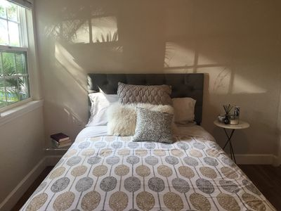 Warm and inviting guest room with perfectly comfy pillow top bed and big closet.