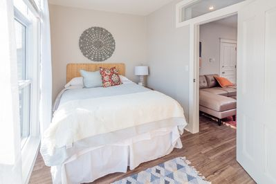 Beautiful bright bedroom with queen sized bed.
