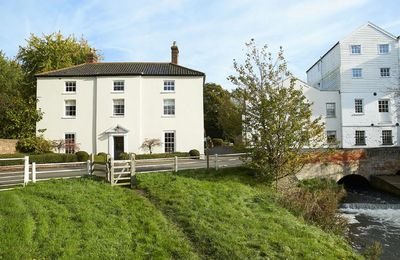 This impressive property overlooks the River Bure and sits alongside the large mill building