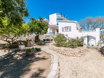 Photo for AQV11- BEAUTIFUL CHALET TO METERS FROM THE BEACH