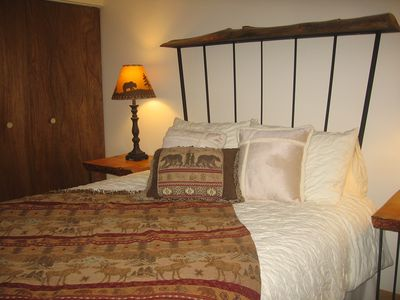 Queen Bed with a custom headboard and end tables made by a local artist.