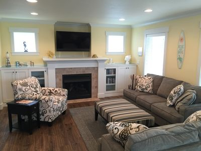 "Living Room w/ 50"" LED Smart TV and gas fireplace"