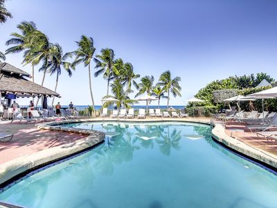 Photo for Beachfront condo with shared pool, sauna, hot tubs, fitness center, & more