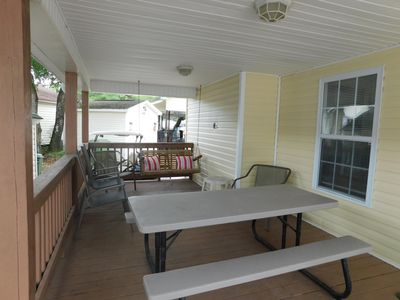 Nice big front porch with swing and picnic table