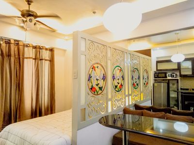 Photo for Cozy 1BR next to Venice Mall at BGC + WiFi