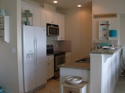 Updated Kitchen with granite countertops and view of Gulf