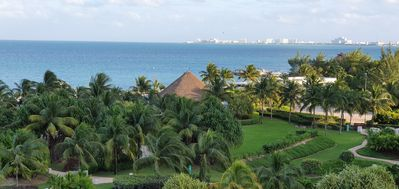 The view from the terrace: the gardens, pool area and beach/ocean