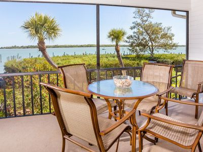 Photo for Watch dolphins, sea otters and osprey from your screened in porch overlooking Pine Island Sound.