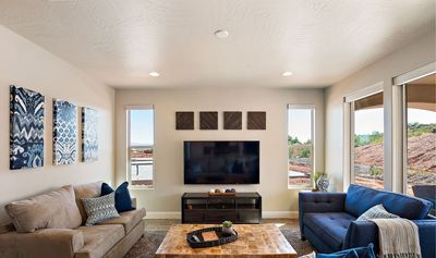 Professionally decorated family room featuring comfortable seating