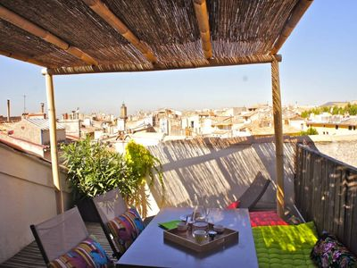 Photo for A nest over the roofs in the heart of Aix en Provence: a very quiet furnished apartment with a large terrace, air conditioning and WiFi.
