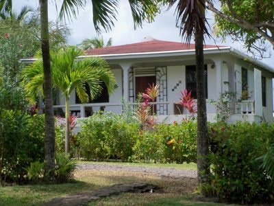 Photo for Peaceful, fully equipped two bedroom cottage overlooking the sea in Calibishie, Dominica