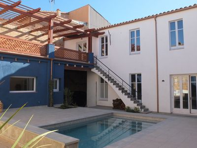 Photo for Beautiful, authentic house with large patio and swimming pool, near the beach