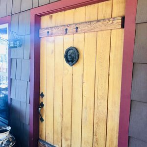 Walk into a bit of history through the giant wood entry door!