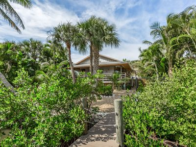 Photo for NEW LISTING! Unique waterfront home nestled in the palms w/private hot tub