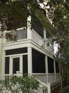 Screen porches upstairs and down.