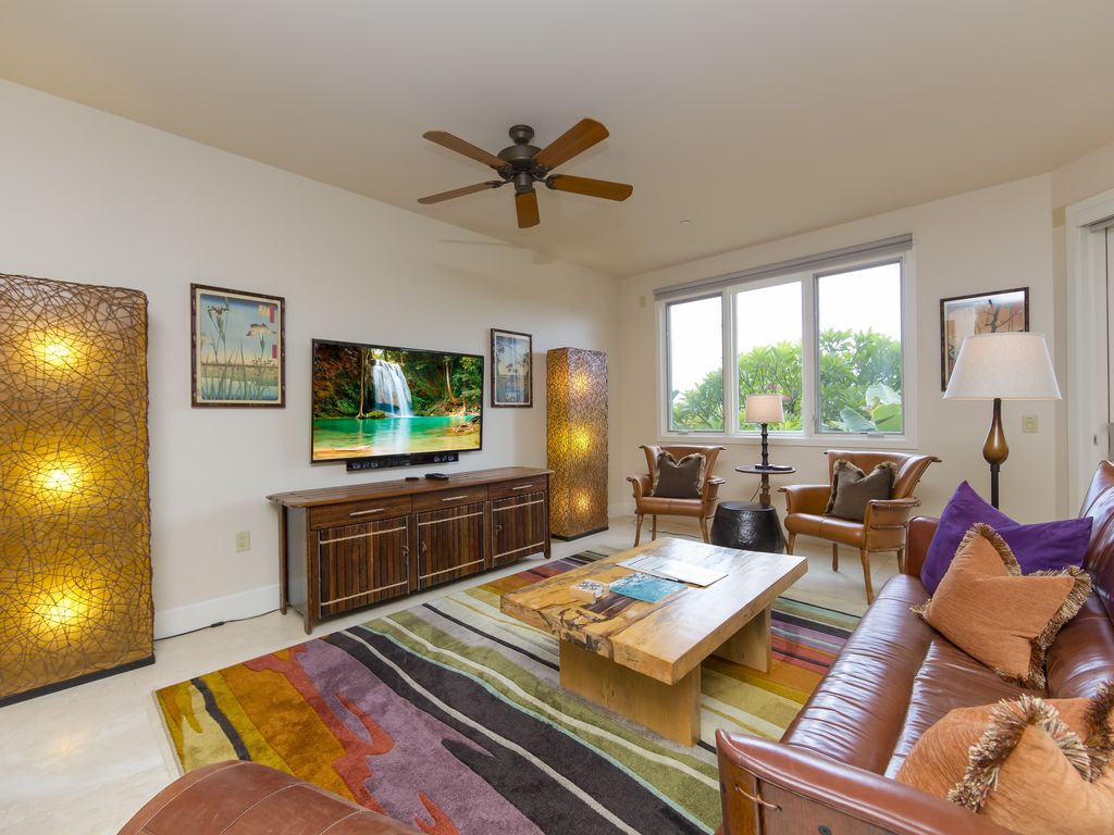 Spacious Living Room With 60 Inch LED LCD Television And Stereo Sound System