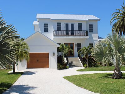 Photo for Elegant Beach House with Private Pool, Minutes From The Beach!